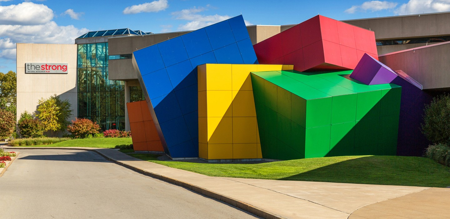 Exterior The Strong Museum showing part of the building made of colorful cubes that look like toy blocks.