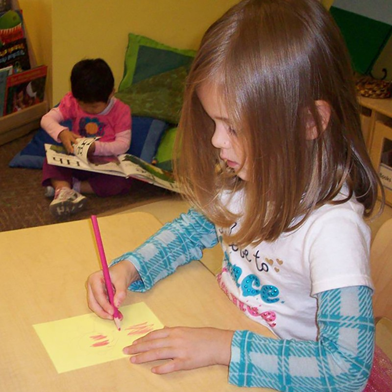 Girl coloring in classroom