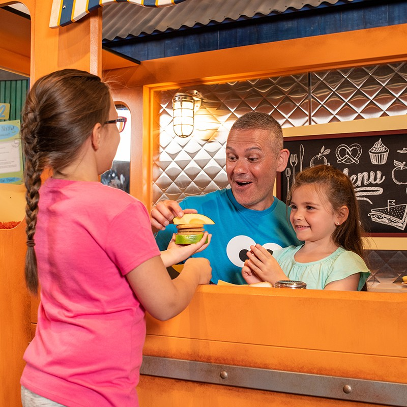 Dad and girls at Cookie monster's foodie truck