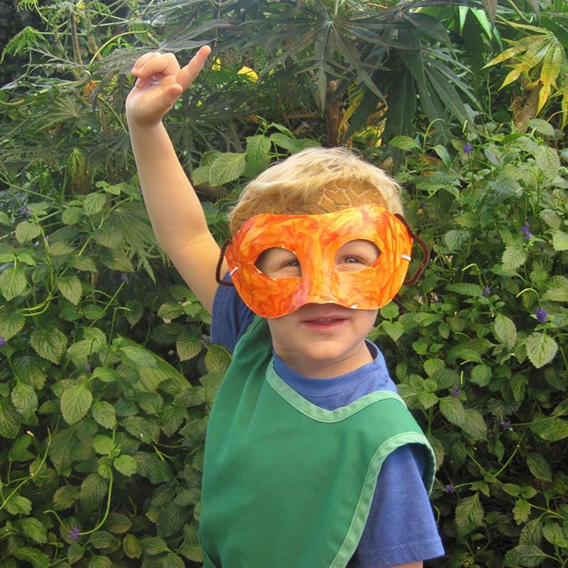 Boy in handmade bird mask