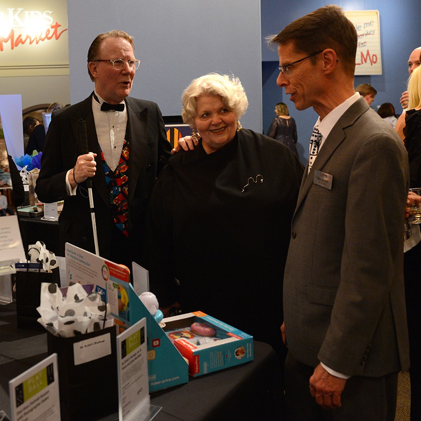 Chris Bensch with board members Bonnie Erikson and Wayde Phillips