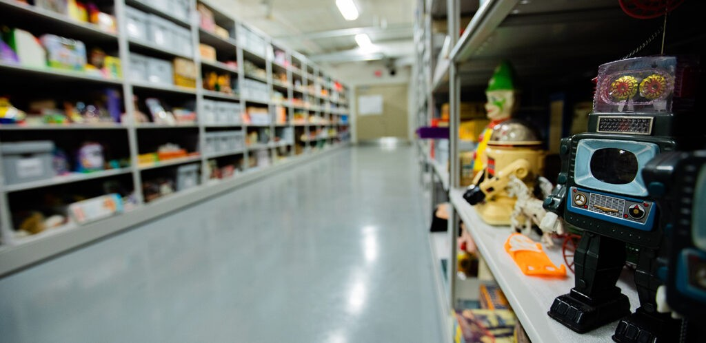 Toys on shelves in museum storage