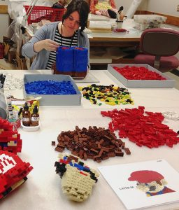 Bethany building LEGO Mario, The Strong, Rochester, New York