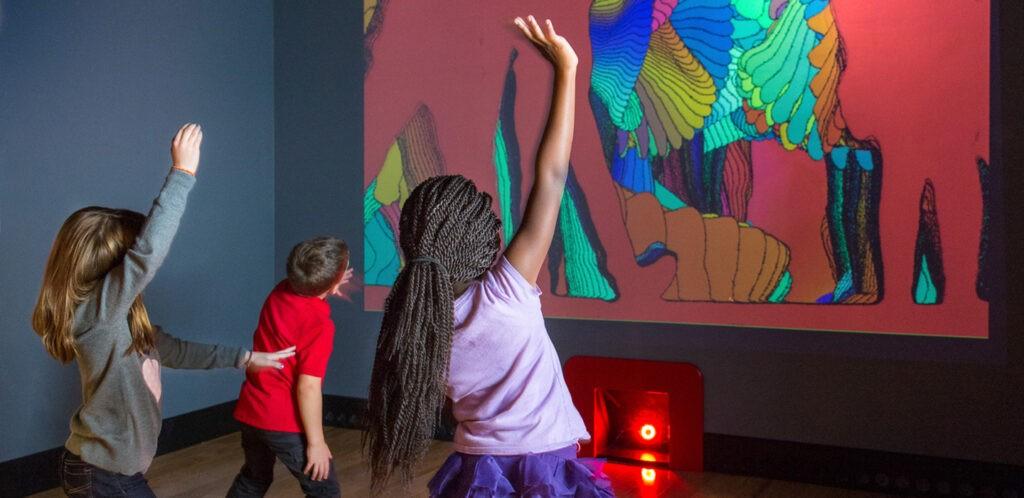 Kids dancing with interactive screen