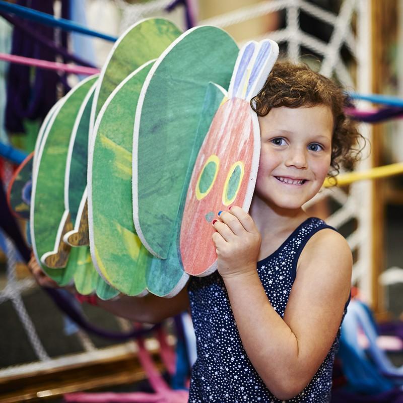 girl holding hungry caterpillar