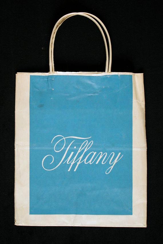 Tiffany shopping bag, gift of Roy Eddey, courtesy of The Strong, Rochester, New York.