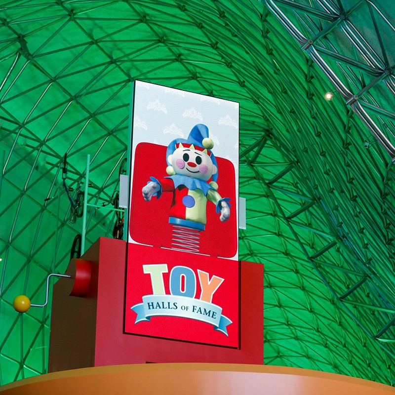 Digital screen on Toy Halls of Fame elevator with exhibit logo