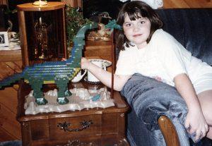 Young Bethany with constructed Mega Bloks Dinobloks Brontosaurus, courtesy Bethany Mosher, Rochester, New York