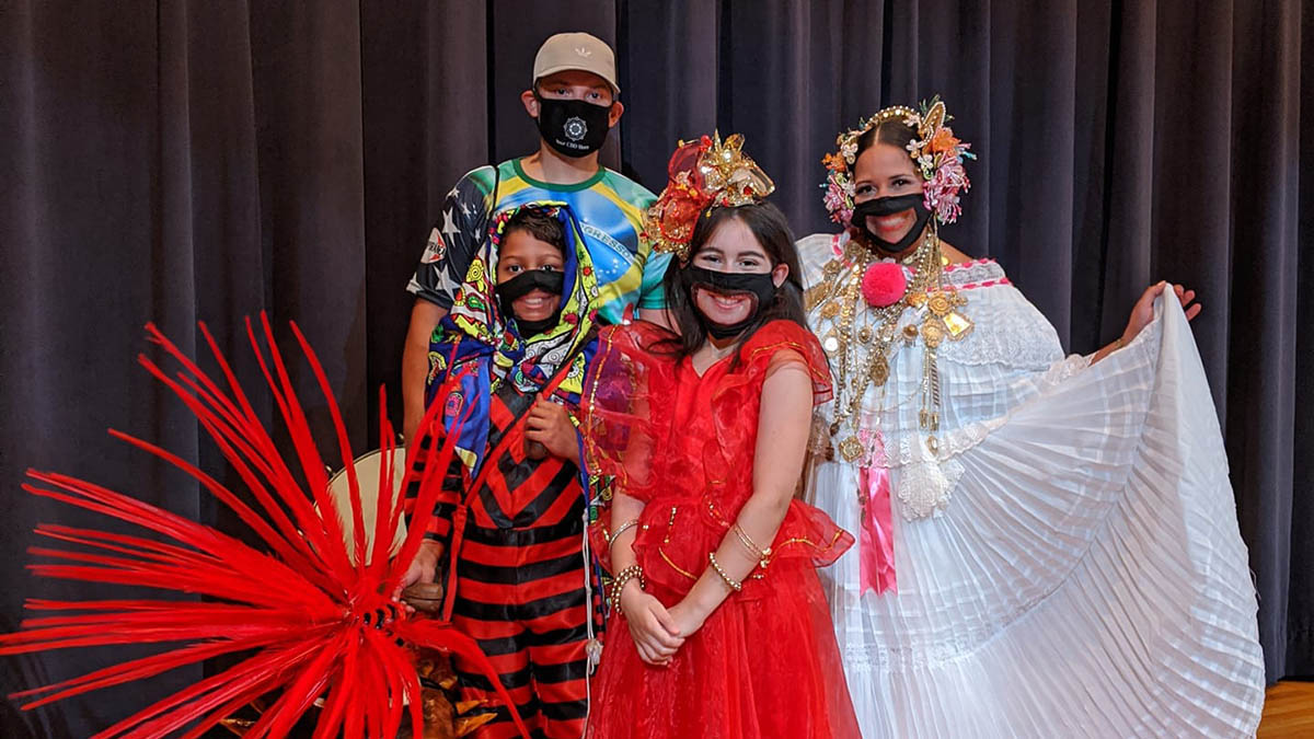 Performance group in traditional hispanic costumes